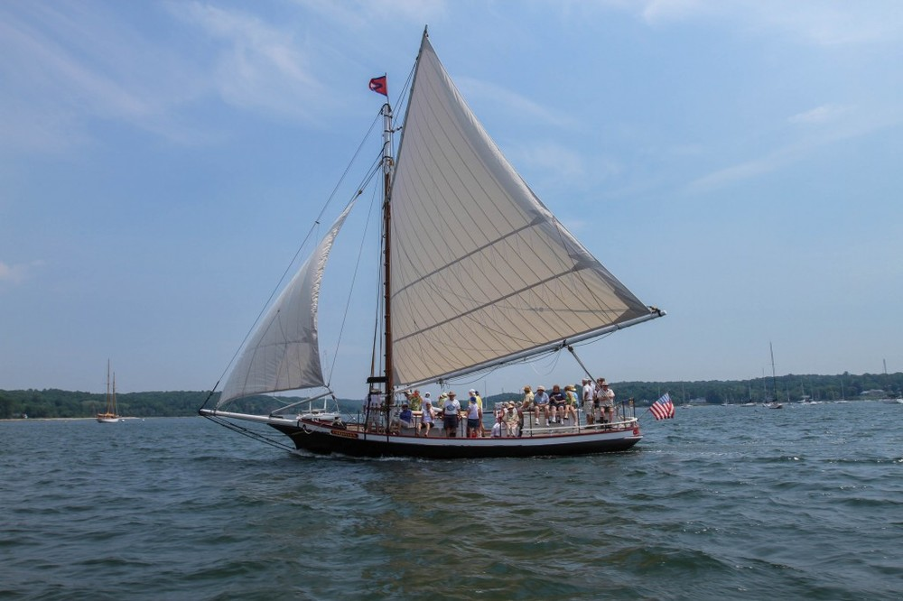The oyster sloop Christeen, pictured above on one of the WaterFront Center's environmental education excursions out of Oyster Bay.