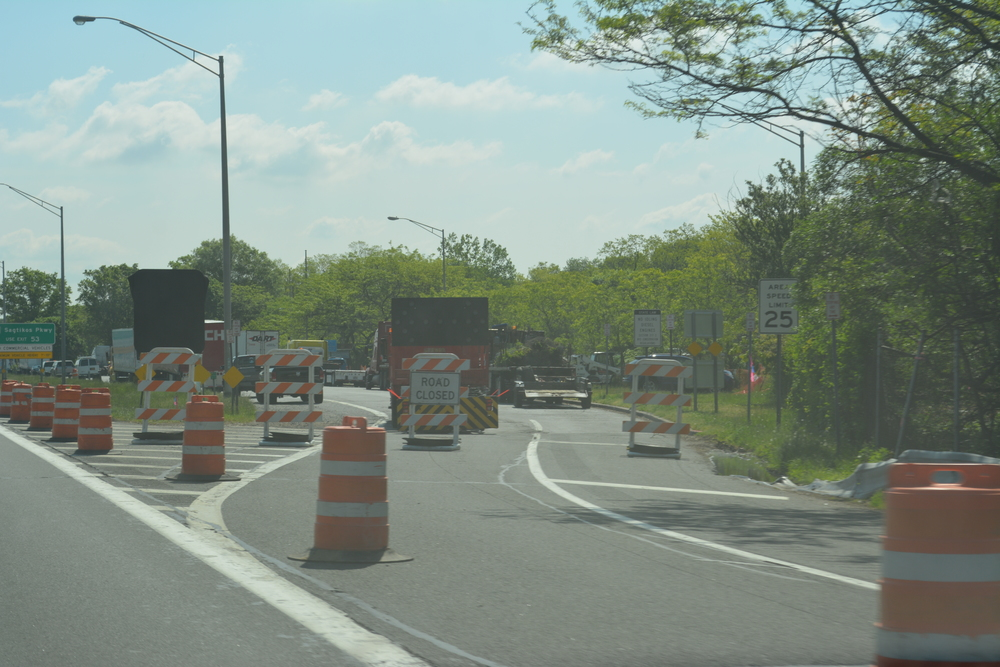 Construction is underway Monday on hotly-contested welcome center being built between exits 51 and 52 on the Long Island Expressway. State officials plan to build a 15,200 square-foot structure incorporating parking for up to 135 vehicles, police substations and a community room.