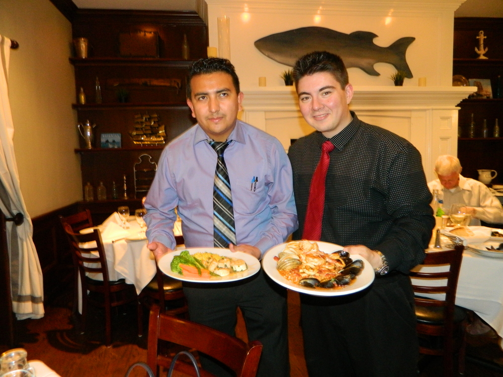 Managers Javier Villatoro, left, and Justin Visconti present Harbor Mist's seafood risotto and sea scallops entrees.
