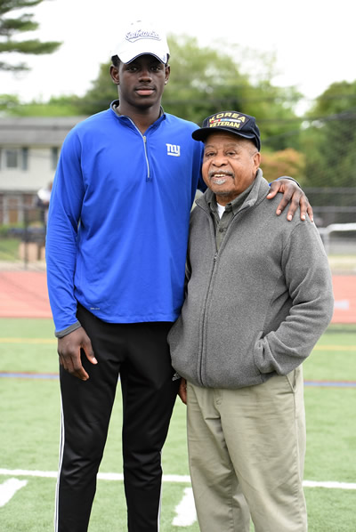 Modern-day track star Infinite Tucker is pictured with 1949 Huntington High School alum Paul Johnson, a Blue Devil star in his own right. Photo/Huntington School District