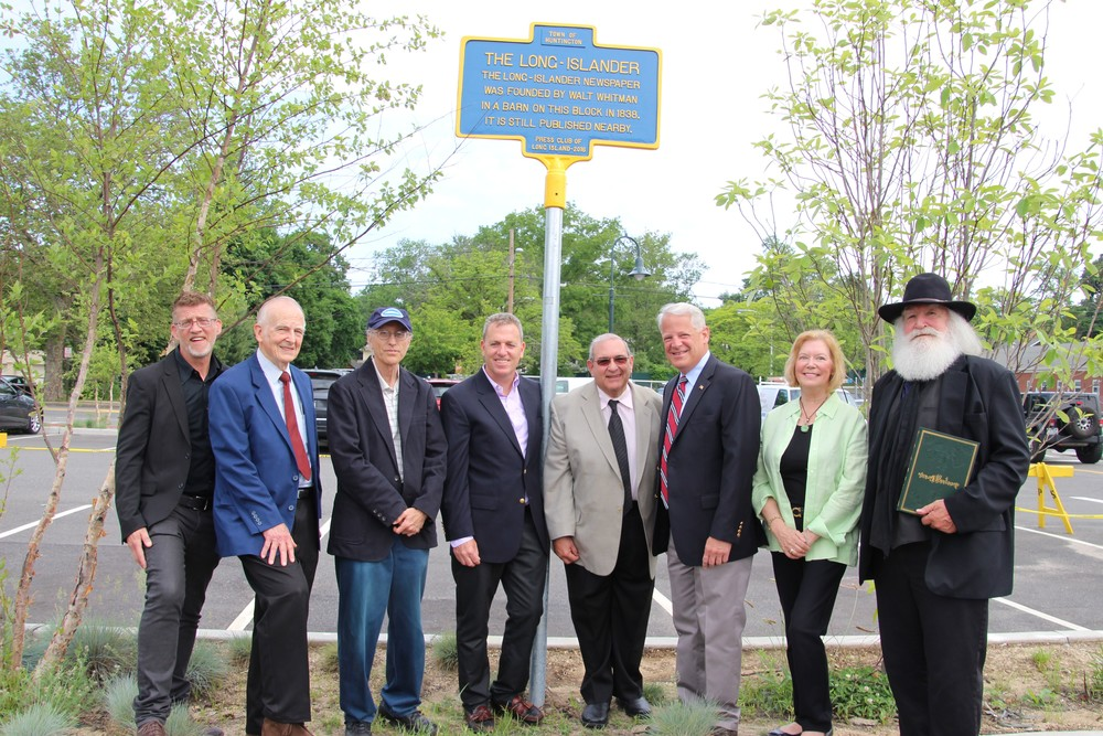 Unveiling an historic marker at the site where The Long-Islander was founded, from left, are: Peter Sloggatt, publisher; Dr. William Walter, Walt Whitman Birthplace Association president; Bill Bleyer, chair of the Press Club of Long Island historic site committee; Huntington Councilman Mark Cuthbertson; Supervisor Frank Petrone; Rep. Steve Israel; Cynthia Shor, Whitman Birthplace executive director; and Walt Whitman himself, aka Darryl Blaine Ford. Photo/Town of Huntington