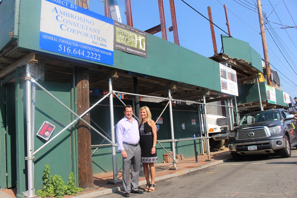 Garden City-based developer Michael Ambrosino and his wife, Jeanine, stand outside of 425 New York Ave. Ambrosino plans to construct a three-story mixed-use building, which is depicted in a rendering, inset.