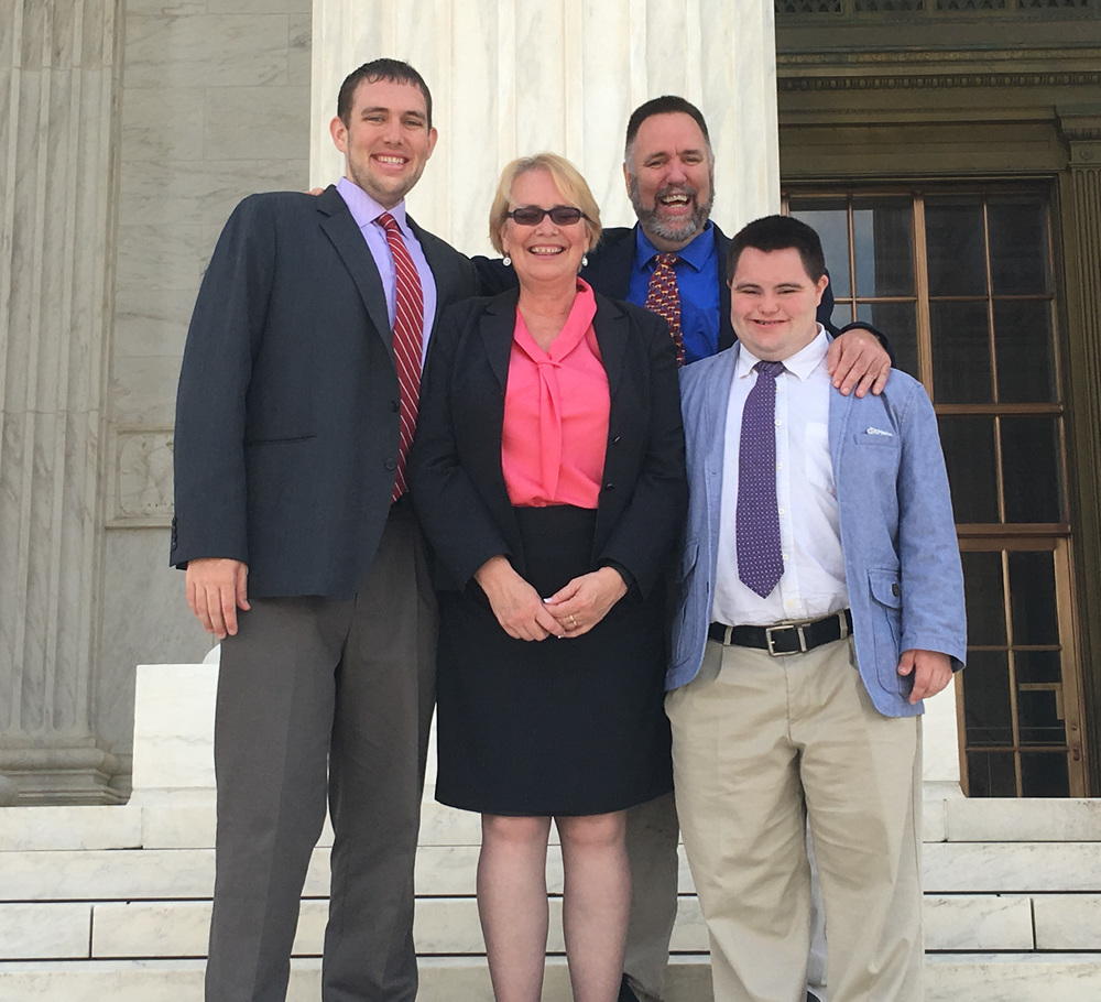 Huntington-based attorney Carol L. Schlitt, center, is pictured outside of the U.S. Supreme Court Building with her family, from left, Patrick Cronin, Mark X. Cronin and John Lee Cronin. On Tuesday, Schlitt was admitted to practice law at the Supreme Court, meaning she may now argue cases before it.