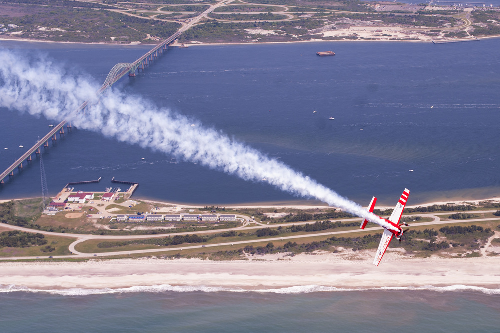 With pilot Sean Tucker on the throttle, Alex Moynihan wielded his own control stick, performing aerial acrobatics like barrel rolls, dives and pull-ups.