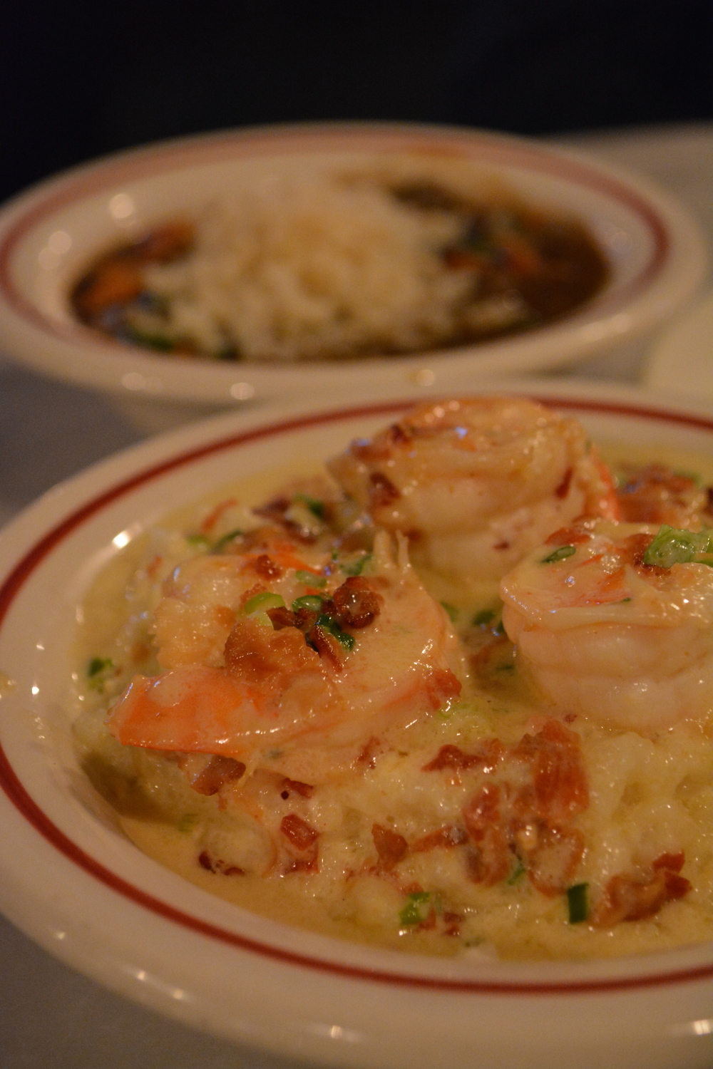 Storyville's shrimp and grits can leave diners thinking about grits for days.
