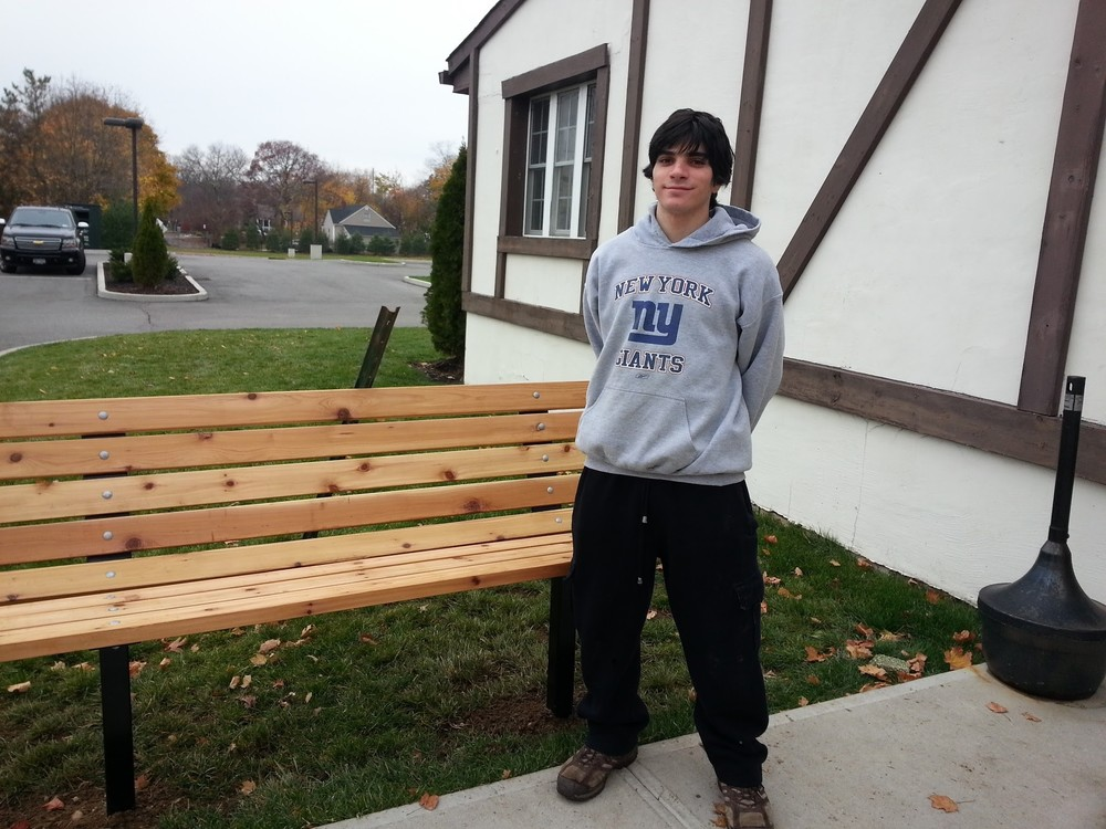 Melville 18-year-old Yanni Agrotis led a project to build three new benches at St. Michael the Archangel Church in Farmingville. The project was part of the teen's requirements to earn the coveted Eagle Scout rank.