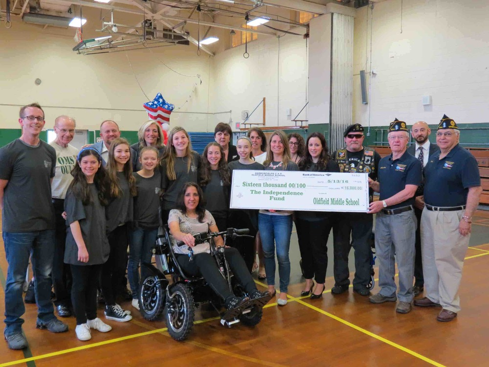 Oldfield Middle School students, faculty and PTA members raised $16,000 to purchase a Zoom Trackchair for veteran Julia Torres through The Independence Fund organization. Photo/Harborfields School District