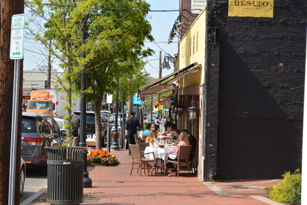 Crowds flock to sidewalks across town, including at Besito on New York Avenue in downtown Huntington.