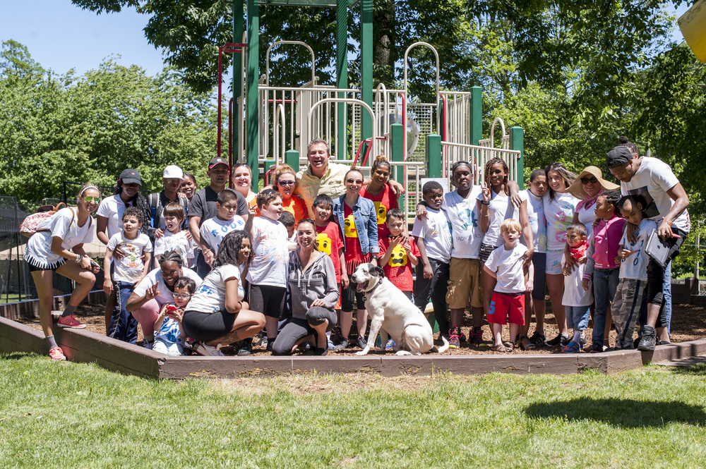 Kevin Gersh (center, top row), founder of the Gersh Academy, is pictured here with students and volunteers of the academy's Field Day at the West Hills Day Camp where they engaged in arts and crafts, zip lined and swam.