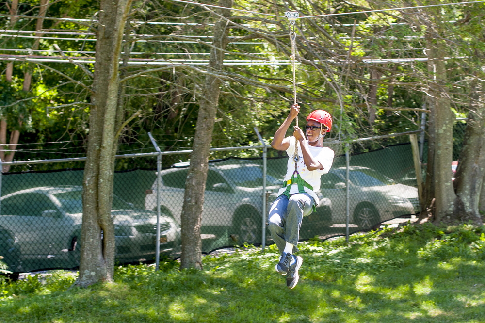 Dakota Gentry, 18, felt as if he was flying while ziplining at the academy's Field Day. On the autism spectrum, he has been a student at Gersh for six years.