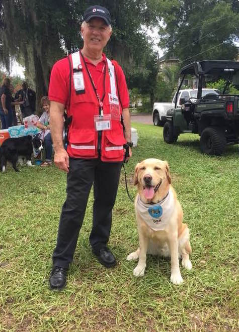 Tom Hlenski, a Long Island Red Cross volunteer, is pictured with Jack, a therapy dog. Hlenski, of Huntington, returned home Wednesday after a weeklong stint in Orlando, aiding those affected by the June 12 shooting at Pulse nightclub.