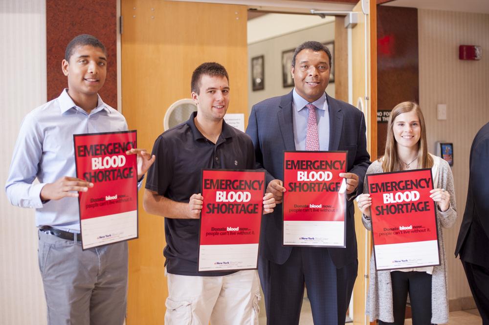 "Suffolk Legislator William ""Doc"" Spencer announces a blood emergency on Friday. Spencer is pictured with interns, from left: Robbie Spencer, who's also the legislator's son; Alex Noon; and Hannah Willen."