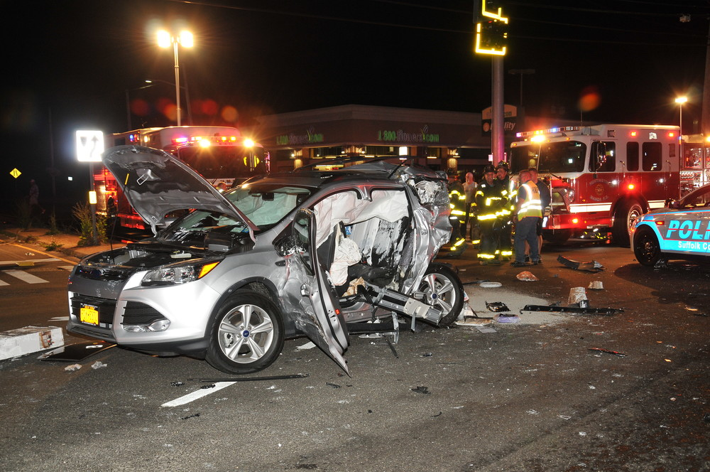 An alleged drunk driver struck a car as its occupants were waiting to turn left on Jericho Turnpike. A passenger in the car, Karen Holden, of Huntington Station, died of her injuries at Huntington Hospital. Photo/Steve Silverman