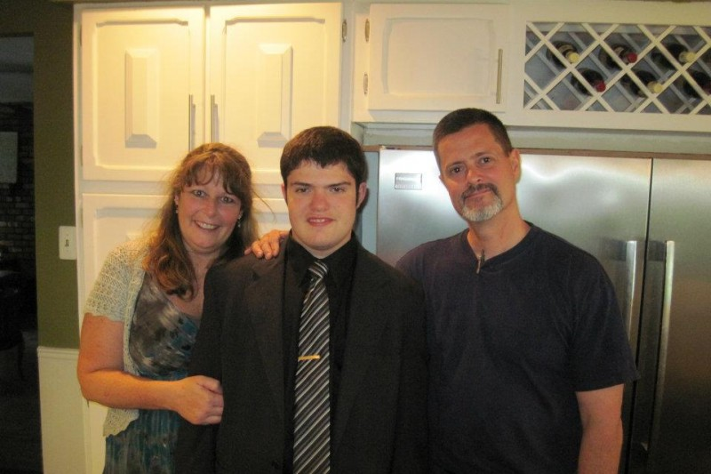 Huntington Station native Karen Holden died after an allegedly drunk driver struck the vehicle she was in on Sunday. She's pictured here with her son Robert and husband William, who were also injured in the crash. Photo/GoFundMe