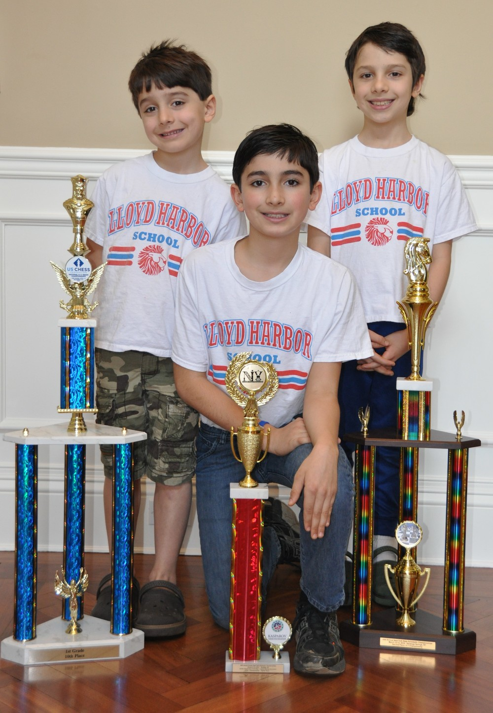 Lloyd Harbor 6-year-old Sebastian Prestia, left, is the top-ranked chess player in the country in his age bracket, according to the United States Chess Federation. Sebastian is pictured with older brothers Paris Prestia, the fourth-ranked 10-year-old chess player in New York, and Frankie Prestia, the third-ranked 8-year-old chess player in the state.