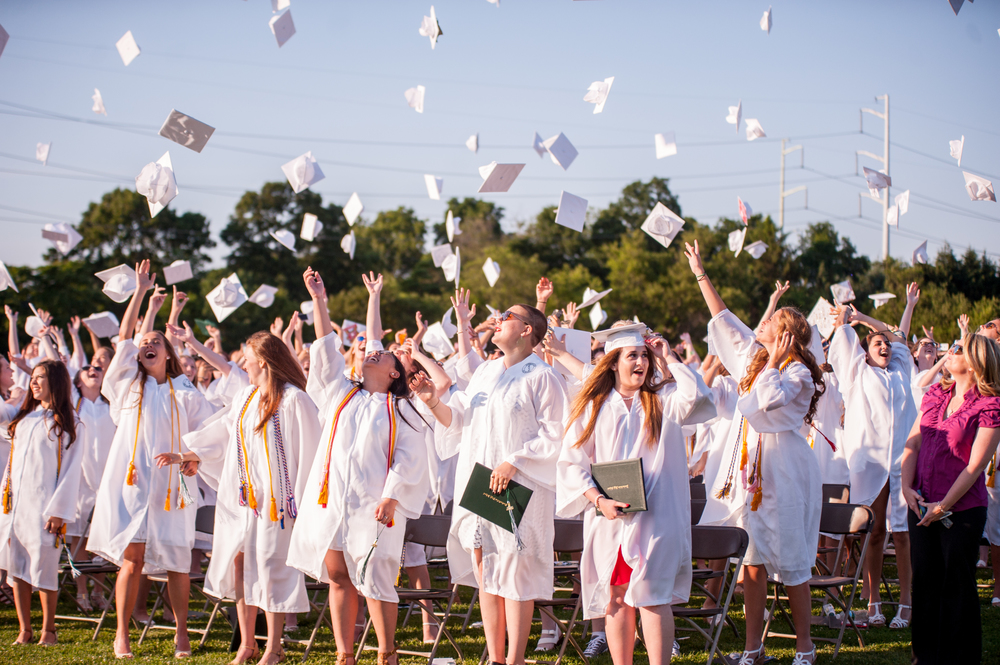 Members of Harborfields High School's graduating class toss up their caps to celebrate their take off into the world beyond 12th grade.