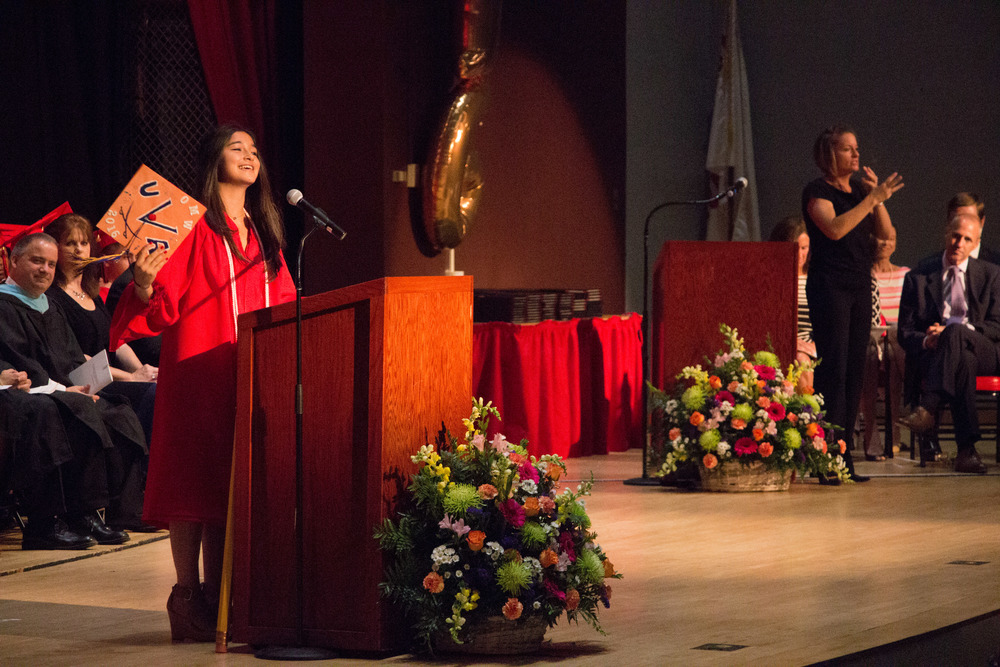 "Cassandra Grello, left, started her salutatorian address with a conclusion, and finished with an introduction because ""this is not the end,"" for the Class of 2016, ""it's the beginning"""