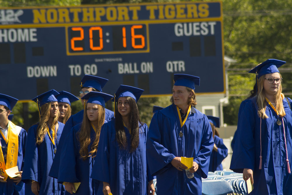Members of Northport High School Class of 2016 enter the field to find their seats Saturday as the school's annual commencement ceremony begins.