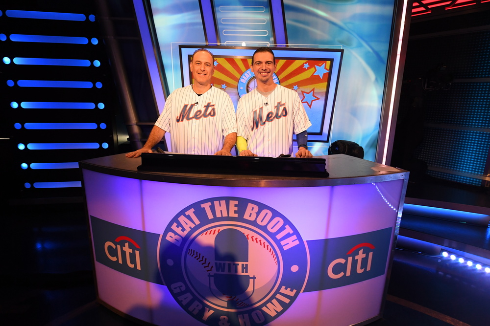 "Adam Yanover, left, of Melville, is pictured on the set of trivia game show ""Beat the Booth"" with teammate Anthony Furia, of Brooklyn."