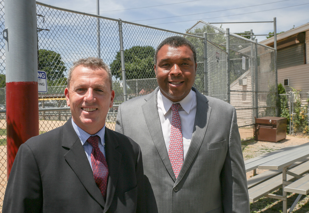 "Huntington Councilman Mark Cuthbertson, left, announced Tuesday a proposal to ban smoking at athletic fields in Huntington. Cuthbertson is pictured alongside Suffolk Legislator William ""Doc"" Spencer."