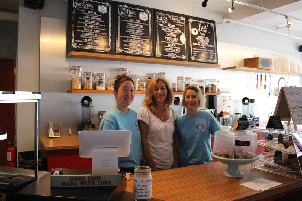 Jacki Ho, Eileen Lesser and Andrea Witc, of Kala Luna Juicery, stand behind the counter to prepare the store for a day of customers.