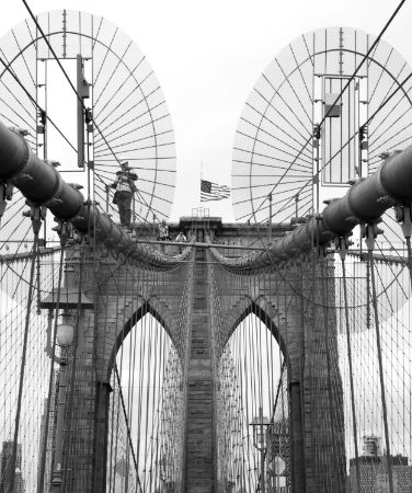 """Men At Work,"" by Alexa Forberg, of Huntington, photographs construction workers walking across the steel bars of the Brooklyn Bridge."