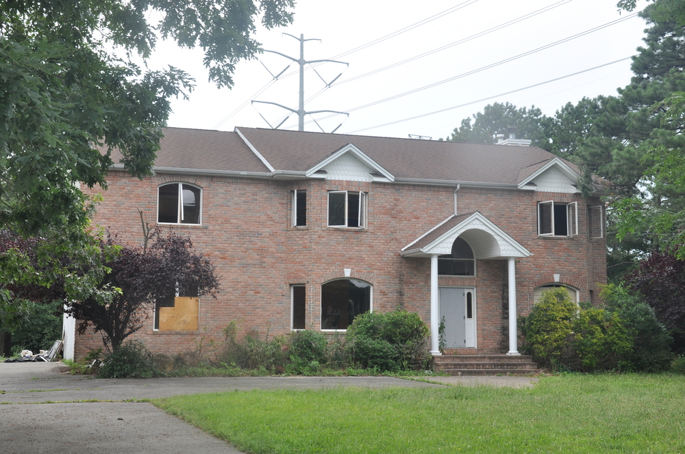 The Huntington Town Board is hosting two public hearings next month on proposals targeted at blighted buildings, such as this home at 266 Pine Acres Blvd. in Dix Hills.
