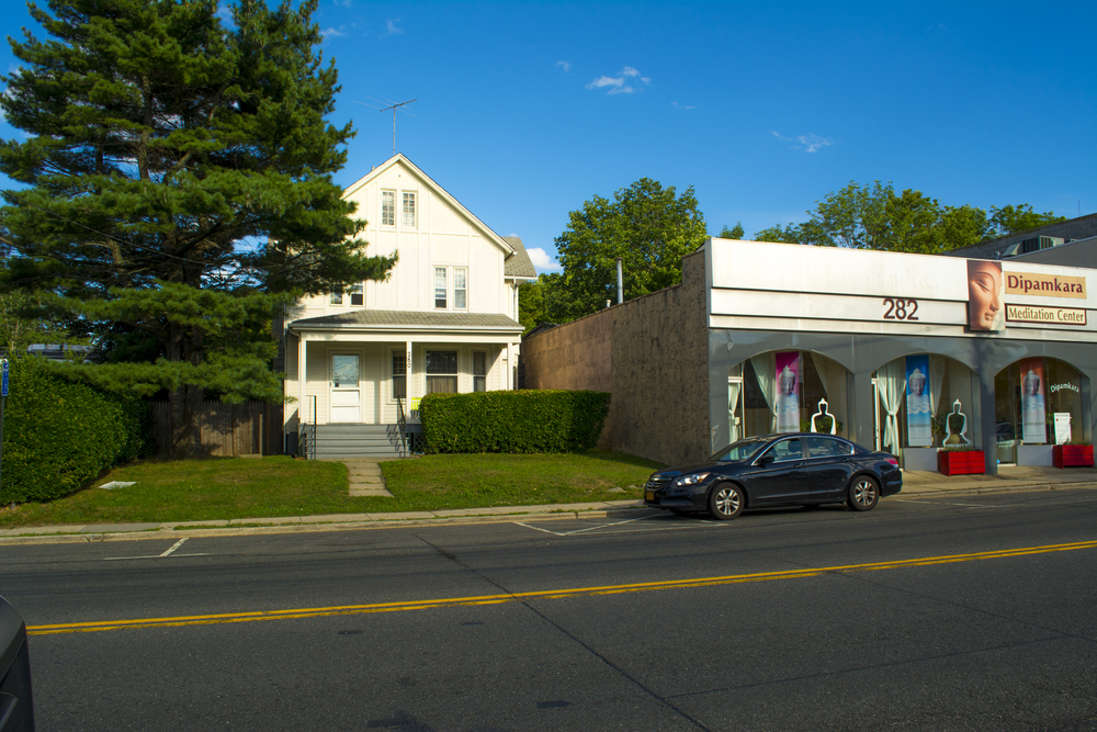 A developer is planning to build a three-story commercial building with residential apartments at this site, left, on New York Avenue in Huntington village.