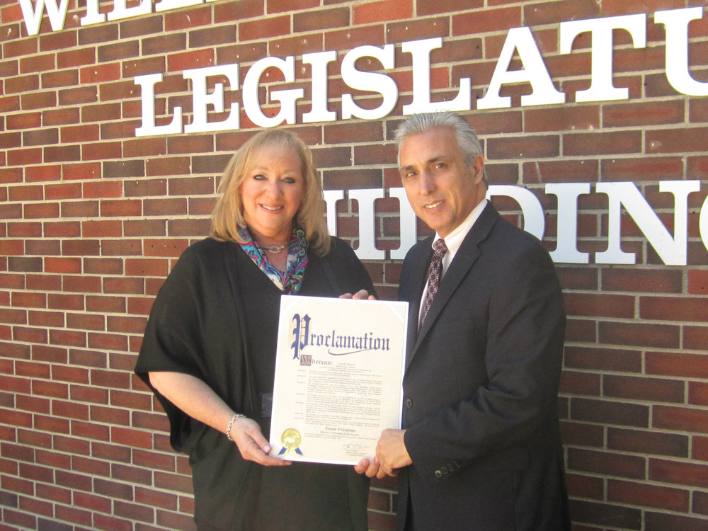 Suffolk County Legislator Lou D'Amaro (D-Huntington Station) has selected longtime Dix Hills resident Susan Friedman as the 2016 woman of distinction for Suffolk's 17th legislative district. Photo courtesy of Legislator Lou D'Amaro's office
