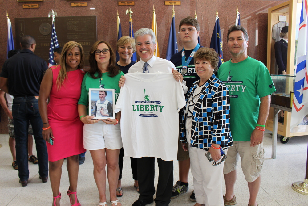 Team Liberty, who will be raising funds for organ donation advocacy, gives Suffolk County Executive Steve Bellone an honorary Team Liberty t-shirt for the Catholic Health Services Suffolk County Marathon, Half Marathon and 5k.