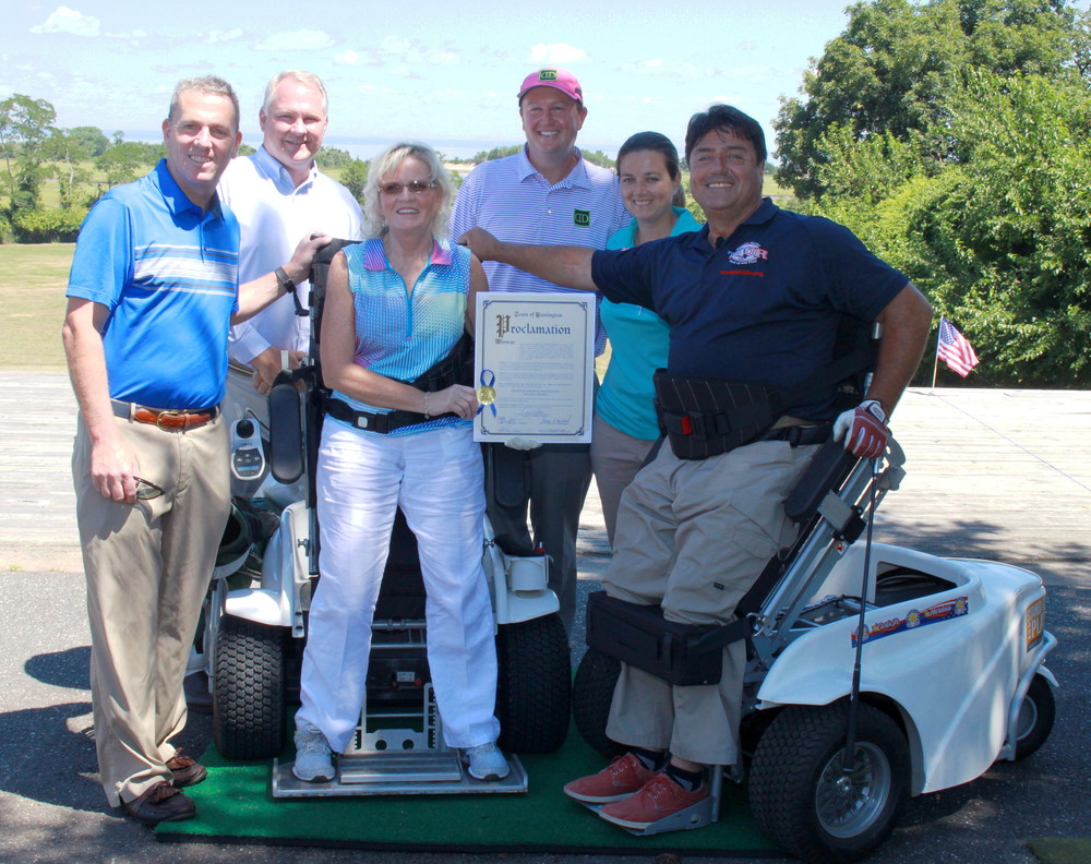 Pictured at a recent golf outing that raised funds to buy a ParaGolf wheelchair, from left, front row: Huntington Councilman Mark Cuthbertson; outing organizer Breid Fischer; and Stand Up and Play founder Anthony Netto. Back row: Crab Meadow Golf Course Director Mike Gaffney; Crab Meadow Golf Pro Darren DeMaille; and Metropolitan PGA Hope Organization representative Kelly Clayton.