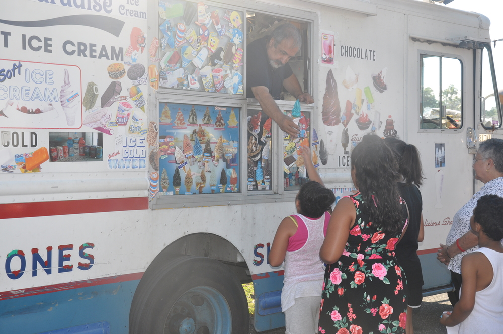 An ice cream truck provides free ice cream to all in attendance.