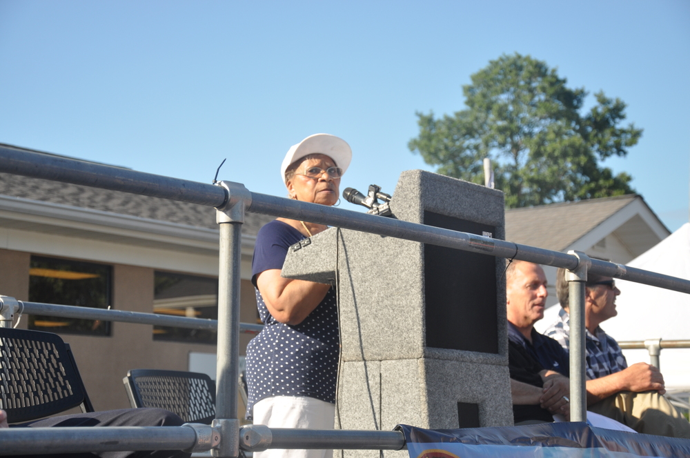Dee Thompson speaks to the crowd at the 34th annual National Night Out in Huntington Station on Tuesday.