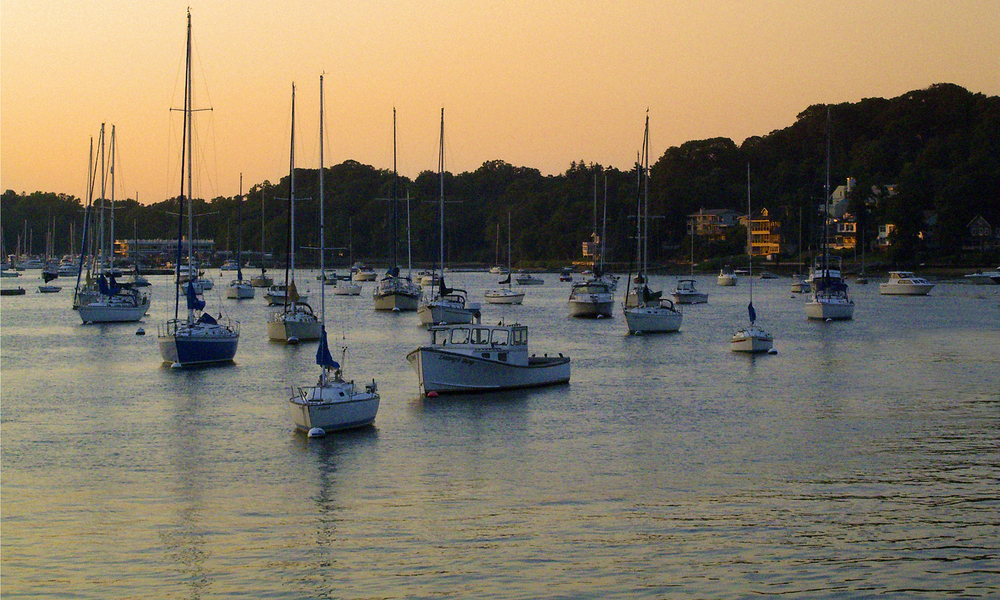"""Huntington Harbor,"" by Mary Ruppert, features boats within Huntington harbor as the sunsets on the water. Photo by Mary Ruppert"