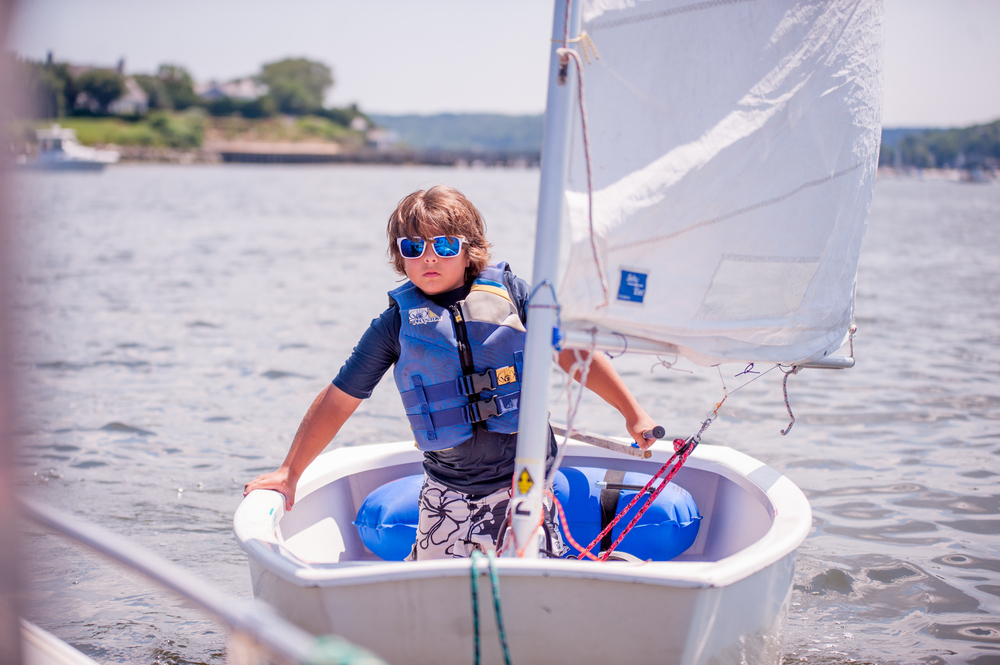 An OPTI Green sailor is pictured getting his sea chops in the Northport Make-A-Wish Regatta.