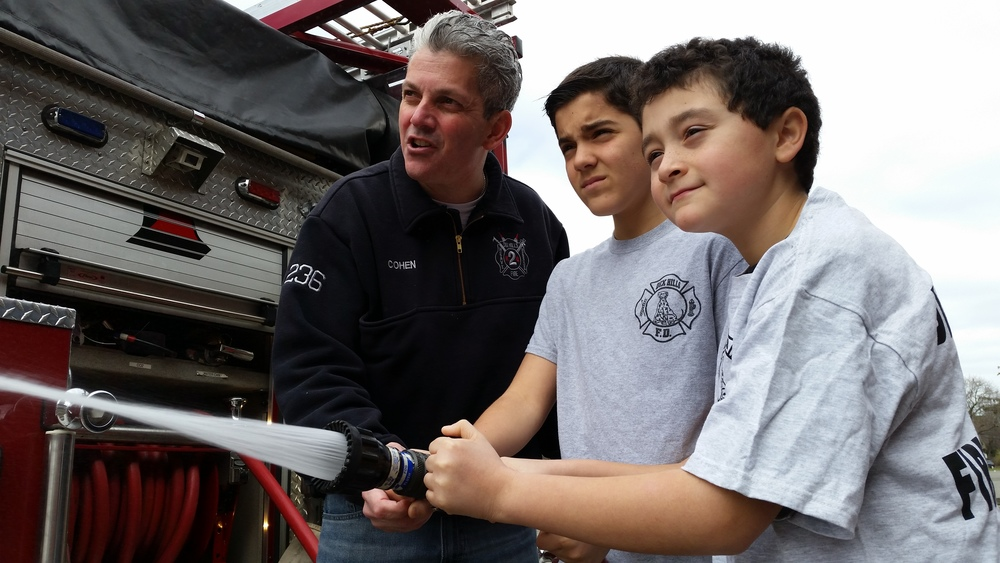Dix Hills Fire Department's Junior Firefighter Academy will teach children ages 12-14 skills needed to help save lives and will also see live demonstrations of fighting a fire, working with canine units and more. Photo courtesy of Todd Baker