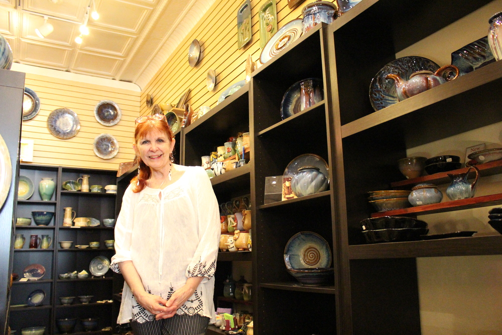 Trisha Phelps, owner of TAS Design & Craft Gallery, said she opened her store to feature the work of American artists who make handcrafted home decor.