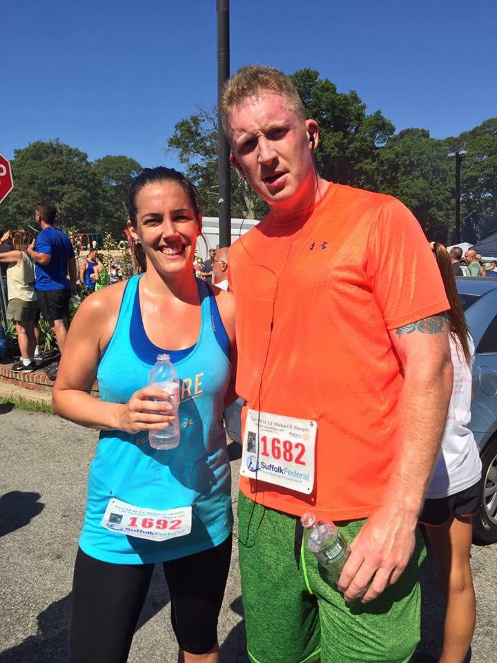 Huntington's Kathy Wagner, left, will be one of nine runners participating in the upcoming TCS New York City Marathon as part of Team Mission United. She is pictured with Sean Vogel.