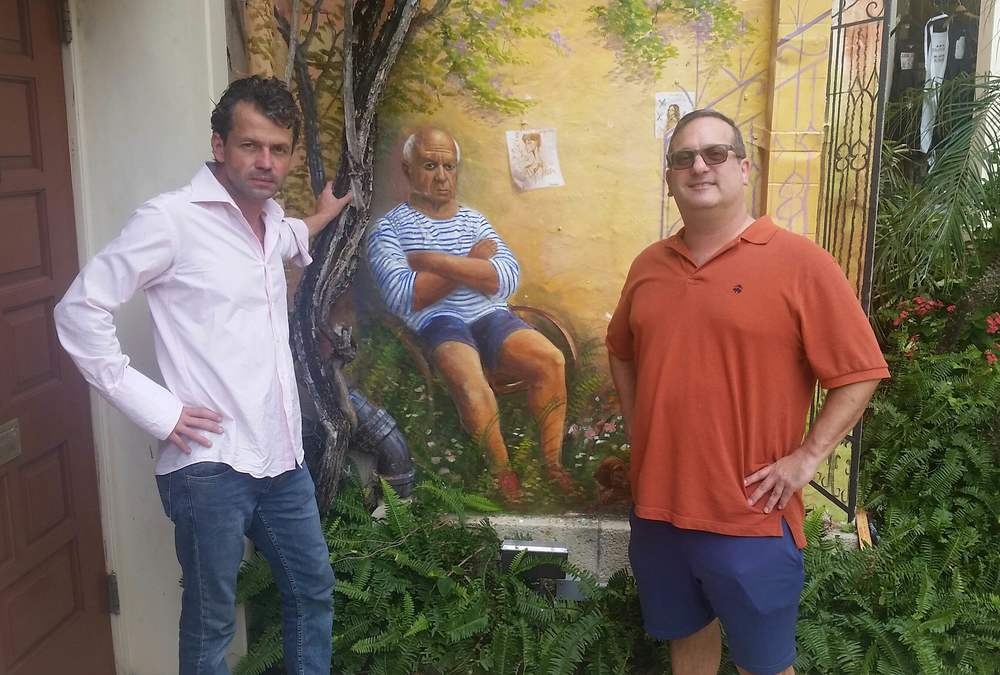 Huntington-native Alex Gardega, left, is on a mission to paint a mural depicting Pablo Picasso in four corners of America. Next, he's targeting Northport.