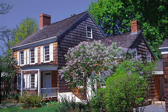 "Walt Whitman, known as ""America's Shakespeare,"" was born at this West Hills home in 1819."