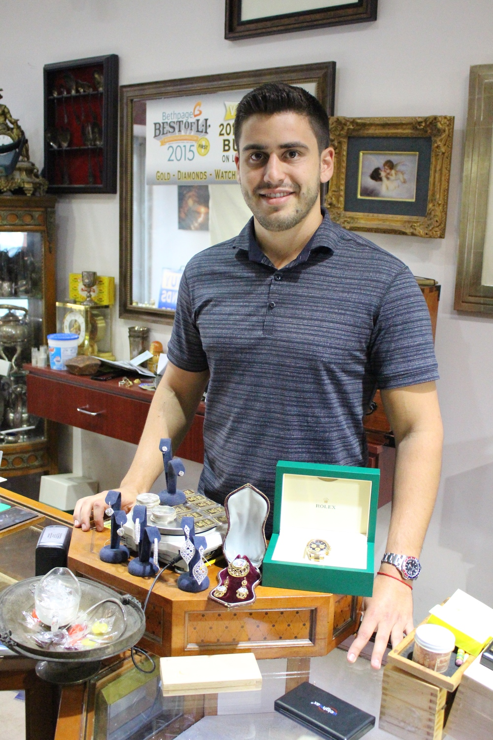Arthur Buz, owner of Collectors Coins & Jewelry in Huntington, who also serves as the stores on-site gemologist and numismatist, says knowledge is very important to the business.