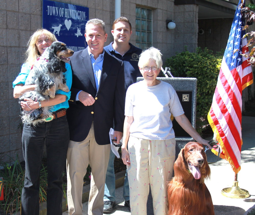 Huntington Councilman Mark Cuthbertson, second from left, is pictured last week at the Town of Huntington's animal shelter in East Northport, where he announced approved Huntington animal code changes aimed at curbing inhumane and unsafe treatment of animals. Cuthbertson is pictured with: Ginny Munger Kahn and Barbara Buscarino, both of nonprofit Long Island Dog Owners Group; Michael Costa, of the shelter; and special guest pups Winslow and Lexi.