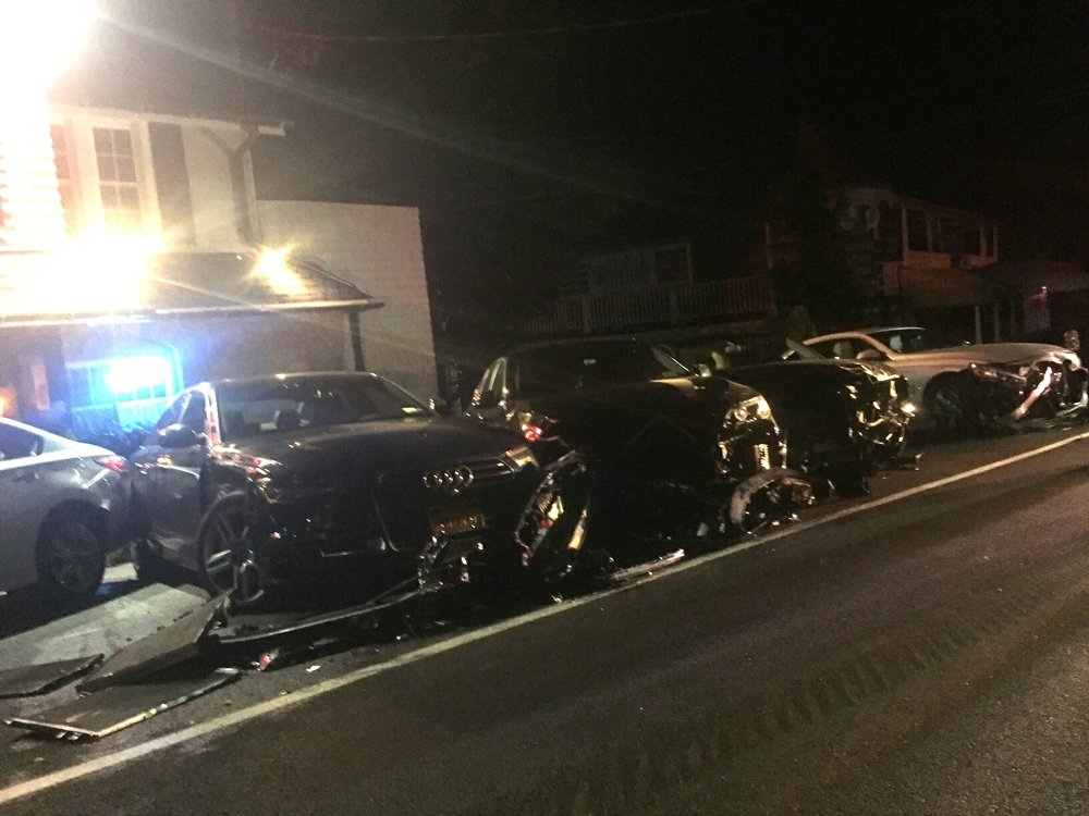 The aftermath Monday night in the parking lot of Mill Pond House Restaurant after an alleged drunk driver crashed his car into nine others, according to Suffolk police.