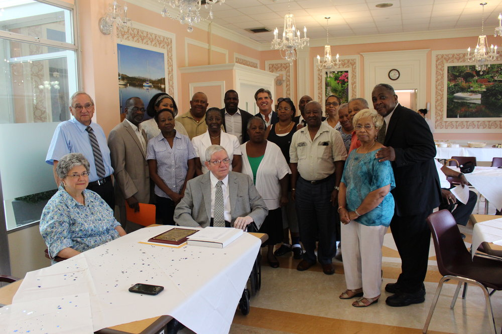 Huntington   officials, members of the Huntington Ecumenical Ministerial Alliance and the NAACP, and religious figures in the community honor Peter Connell, seated center, for his dedicated service to the community.