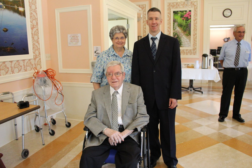 Peter Connell, center, with his wife Frances, left, and son Charles, right, at the Carillon Nursing & Rehabilitation Center, where he was honored for serving the community for over 50 years at the M.A. Connell Funeral Home.