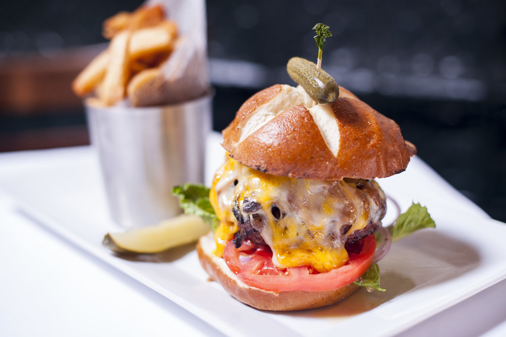 The Finnegan burger takes the pub burger to the next level with a blend of cheeses and a warm pretzel bun.