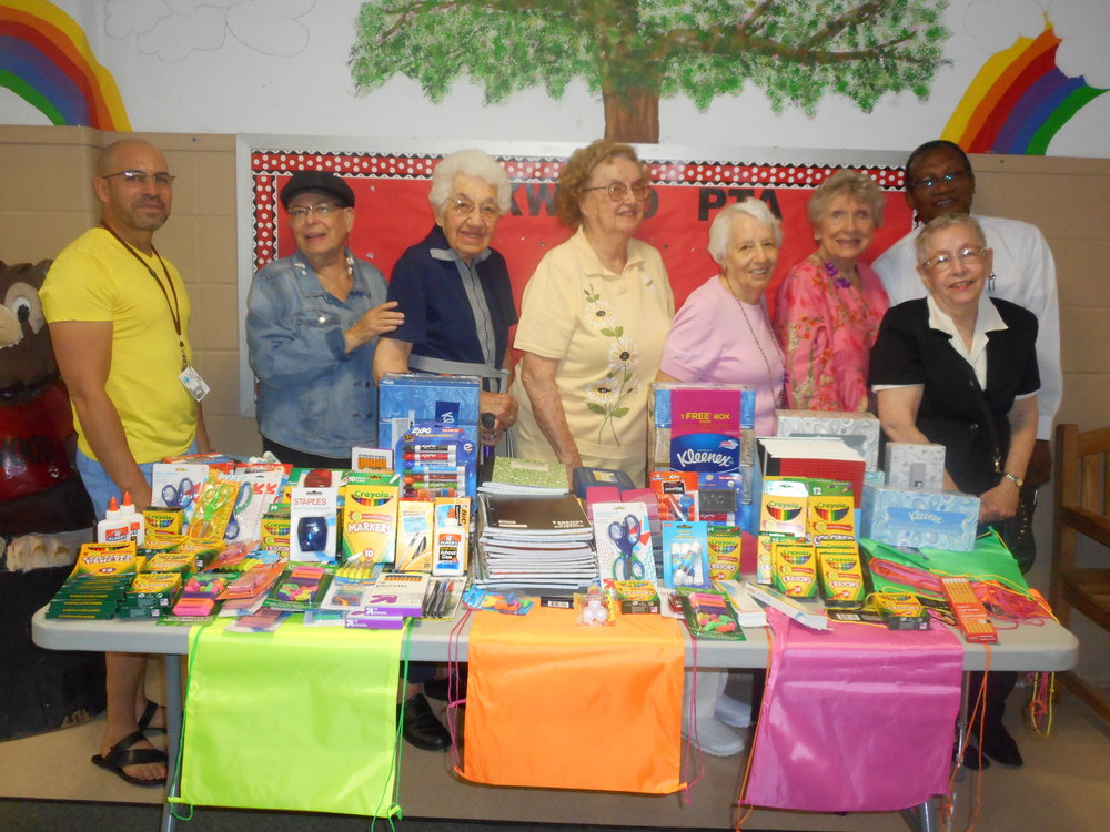 After raising money to purchase school supplies, residents and staff members of Brandywine Living at Huntington Terrace present school supplies to Oakwood Primary Center.*Photos courtesy of Leigh Marchitto