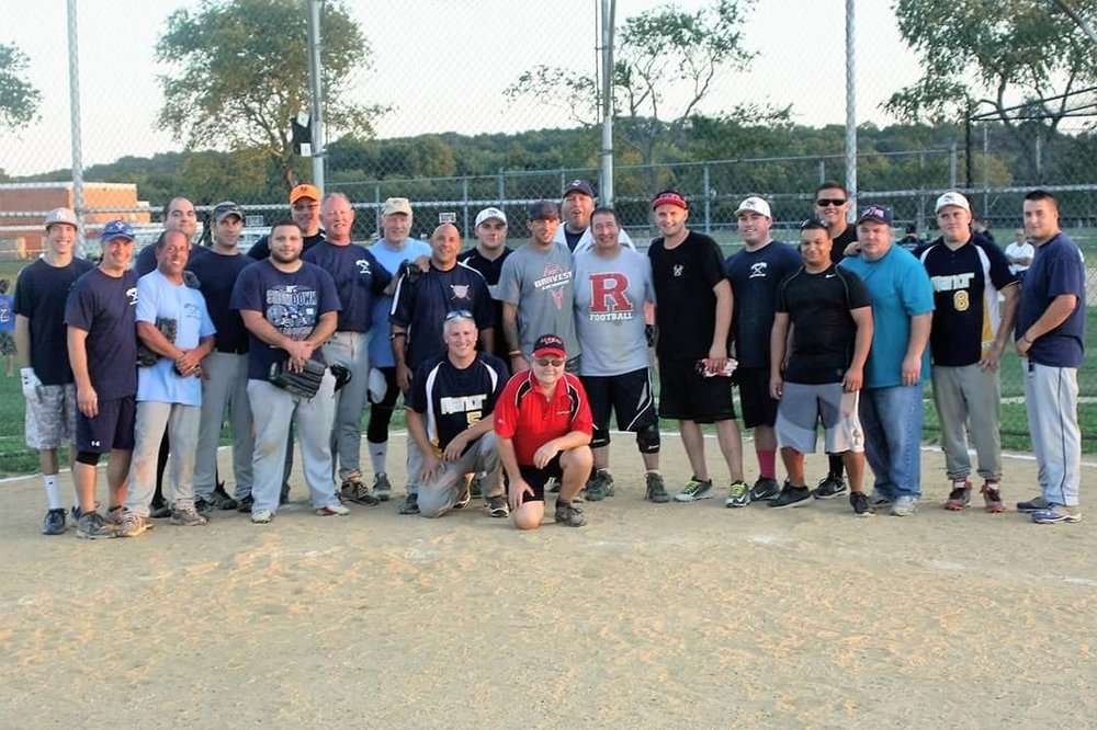 Members of both the Huntington Manor Fire Department and Suffolk Police Department's 2nd Precinct are pictured at the 28  th   annual charity softball game that the two sides have used to raise money for local causes. *Photo by Ron Schankin