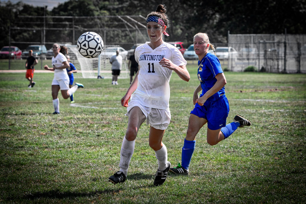 *Photo by Mike Connell Huntington's Ryann Gaffney, a member of the school's soccer, track and lacrosse teams, chases down the ball.