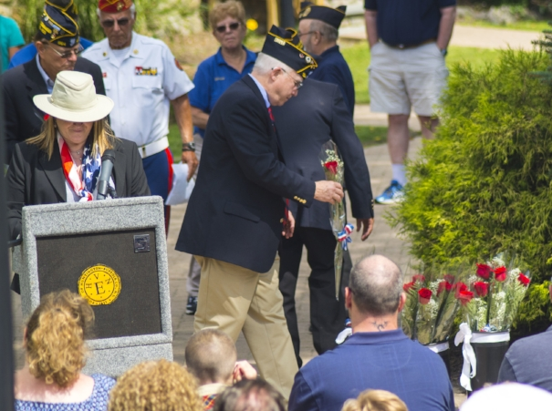 Long Islander News photos/Andrew Wroblewski As Huntington Councilwoman Susan Berland, left, reads names of Town of Huntington residents who died in the 9/11 terrorist attacks, Huntington Veterans Advisory Board Member Bob Santo, center, sets down a rose in remembrance.
